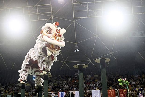 Team A performing at the finals of the International Lion Dance on Stilts competition in Penang.