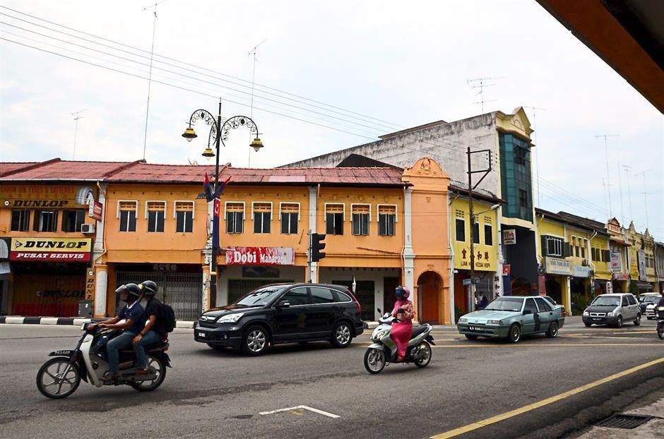 Just like the old days: A row of pre-war shophouses in Bandar Maharani, Muar.